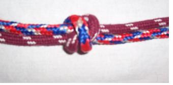 Круглый узелок, с буквой «х» с двух сторон